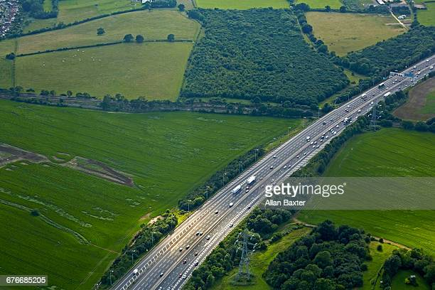 aerial view of the m25 in essex - motorway stock pictures, royalty-free photos & images