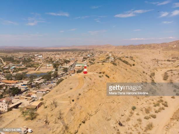 aerial view of the mancora lighthouse on the arid terrain of the peruvian coast. - mancora fotografías e imágenes de stock