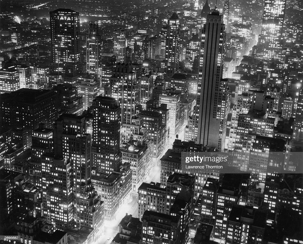 Aerial view of the Manhattan skyline at night, looking southeast down Fifth Avenue, from the RCA Building Rockefeller Center, New York City.