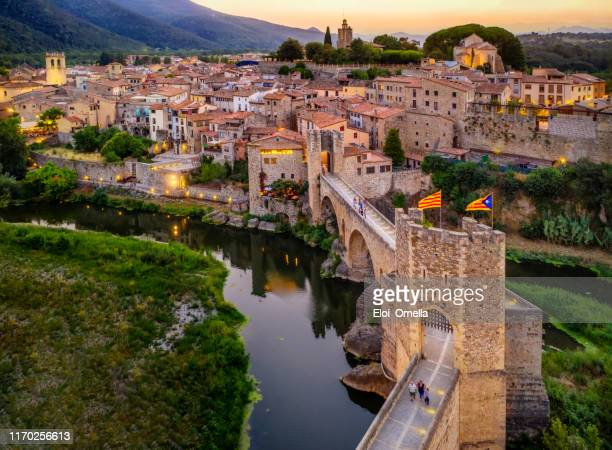 aerial view of the medieval bridge of the besalu at dusk. catalonia, spain - catalonia stock pictures, royalty-free photos & images