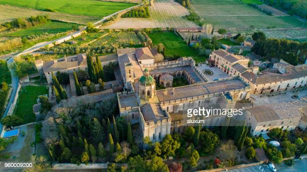 aerial view of the  monastery of santes creus. completed in 1225 it is one of the most important cistercian monasteries in catalonia. in 1835 the monks left the monastery and was declared a national monument in 1921 - tarragona stock photos and pictures