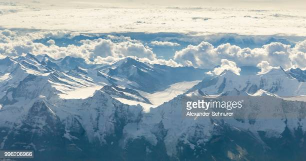 Aerial view of the mountains Eiger, Moench and Jungfrau and the Great Aletsch Glacier at the back, Bernese Alps, Switzerland