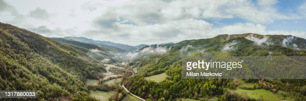 aerial view of the mountains in the fog serbia - balkan mountains - serbia stock pictures, royalty-free photos & images