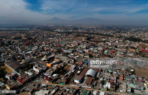Aerial view of the municipality of Tenancingo Tlaxcala state Mexico with the Popocatepetl volcano in the background on January 19 2018 The most...