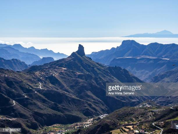 """aerial view of the natural space """"risco caído and the sacred spaces of montaña de gran canaria"""" in tejeda, gran canaria island, canary islands, spain with the teide in the background - tejeda canary islands stock pictures, royalty-free photos & images"""