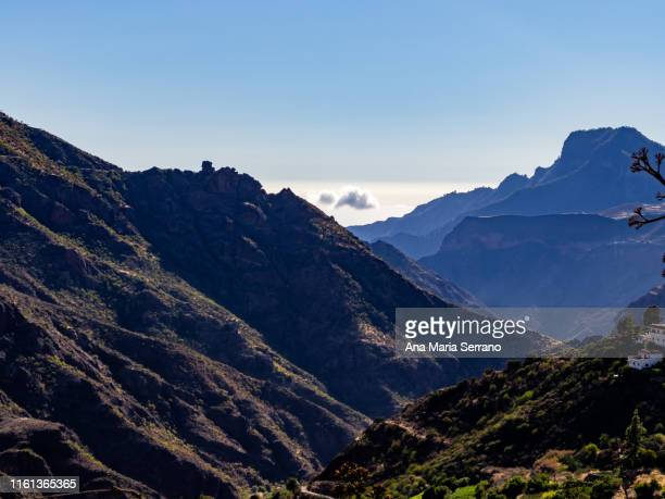 """aerial view of the natural space """"risco caído and the sacred spaces of montaña de gran canaria"""" in tejeda, gran canaria island, canary islands, spain - tejeda canary islands stock pictures, royalty-free photos & images"""