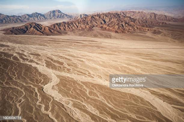 aerial view of the nazca lines from an aircraft. - nazca lines stock pictures, royalty-free photos & images