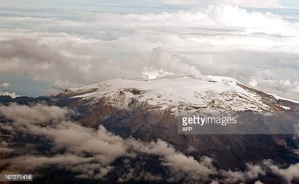 Aerial view of the Nevado del Ruiz volcano showing a plume of smoke and ashes on April 18, 2013 in Colombia. Authorities maintain a yellow alert due...