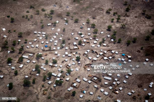 TOPSHOT Aerial view of the new settlement of displaced families in Aburoc South Sudan on June 5 2017 Government offensives on the West Bank of the...