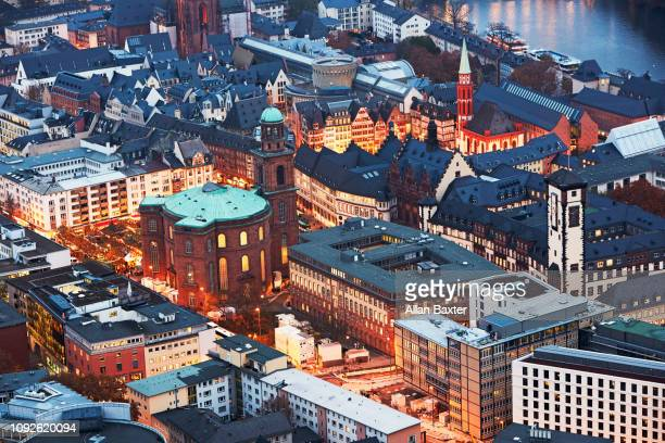 Aerial view of the old city of Frankfurt illuminated at dusk