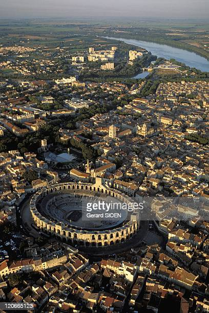 Aerial View of the Old Town and the Arenas in Arles Provence France Bouches du Rhone aerial view of the old town and the arenas The Arena are a Roman...