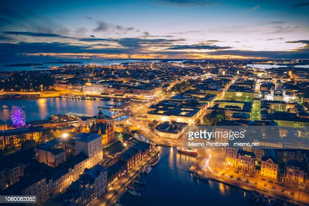 aerial view of the old town of helsinki by night - helsinki stockfoto's en -beelden