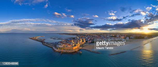 aerial view of the old village of termoli and its beach during sunset - campobasso province, molise region, italy. - molise foto e immagini stock