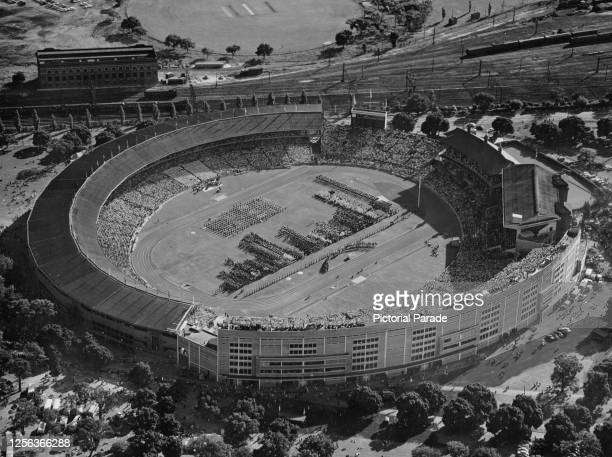 Aerial view of the opening ceremony of the 1956 Summer Olympics, the stands packed with spectators at Melbourne Cricket Ground in Melbourne,...