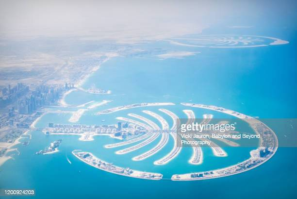 aerial view of the palm jumeirah in dubai - dubai stock pictures, royalty-free photos & images