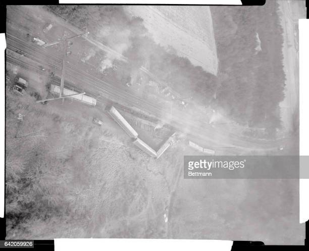 Aerial view of the Pennsylvania Railroad's Embassy passenger train which jumped the tracks while rounding a curve here yesterday killing five persons...