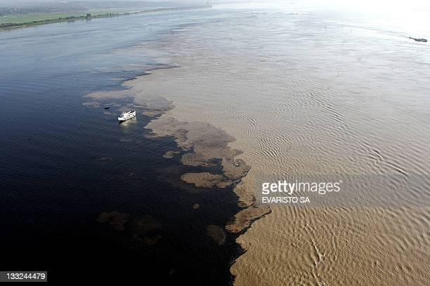 Aerial view of the place where Solimoes and Negro Rivers come togheter with the Amazon River north of Brazil 28 November 2006 AFP PHOTO / Evaristo SA