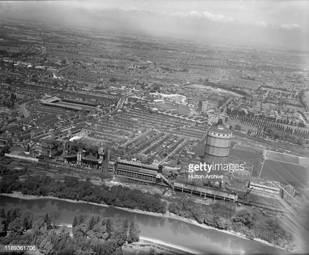 Aerial view of the River Thames at Brentford with Brentford Gas Works in foreground and the Great West Road and Griffin Park Stadium home of...