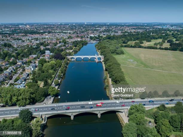 Aerial view of the River Thames flowing past the affluent town of Richmond-upon-Thames, 7 miles south west of Central London. Photograph by David...