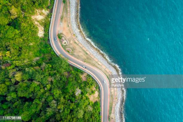 aerial view of the road between the mountains and the sea - 4k resolution stock pictures, royalty-free photos & images