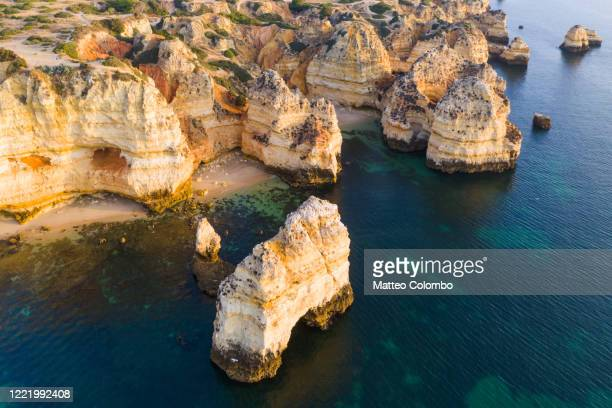 aerial view of the rocky coastline of lagos, algarve, portugal - rocky coastline stock pictures, royalty-free photos & images