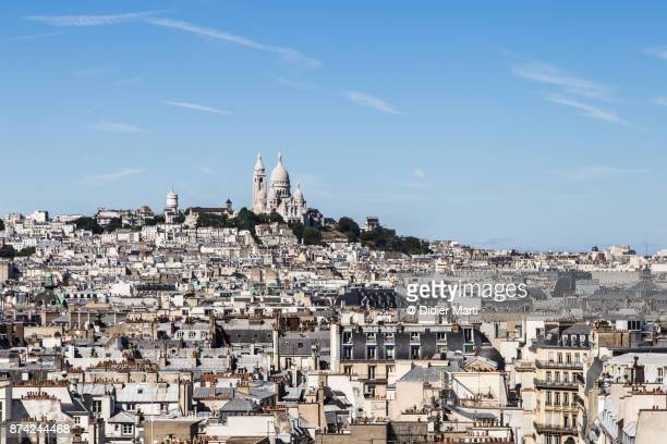 Aerial view of the roofs of Paris with Montmartre basilica