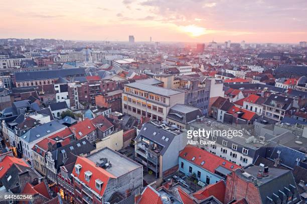 aerial view of the rooftops of ghent at sunset - belgium stock pictures, royalty-free photos & images