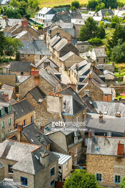 aerial view of the rooftops of residential buildings of the medieval town of fougères - ille et vilaine stock pictures, royalty-free photos & images