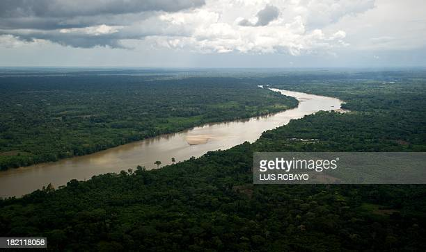 Aerial view of the San Miguel River in the department of Putumayo Colombia on the ColombiaEcuador border on September 27 2013 Ecuador and Colombia...