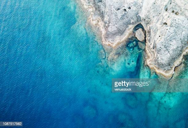 aerial view of the sea and rock - blue stock pictures, royalty-free photos & images