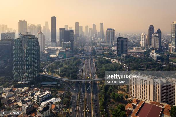 aerial view of the semanggi fly over in jakarta downtown district at sunrise in indonesia capital city - jakarta foto e immagini stock