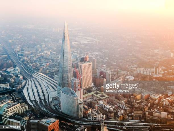 aerial view of the shard at sunset, london, england - shard london bridge stock pictures, royalty-free photos & images