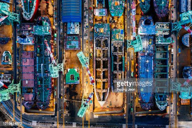 aerial view of the shipyards and docks - harbour stock pictures, royalty-free photos & images