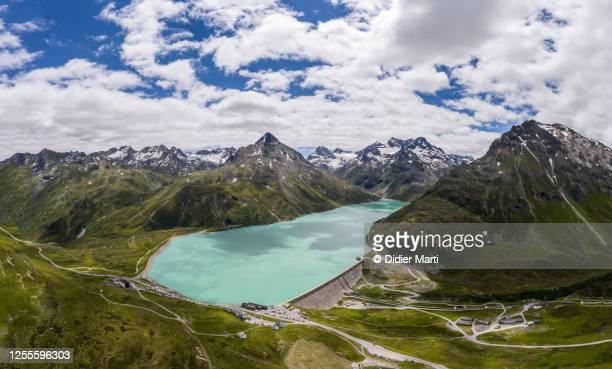 aerial view of the silvretta dam and mountain pass road in the alps in austria - vorarlberg stock pictures, royalty-free photos & images