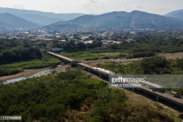 Aerial view of the Simon Bolivar International Bridge over the Tachira river on the border between Cucuta, Colombia and San Antonio del Tachira,...