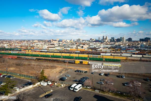 Aerial view of the skyline of downtown Newark New Jersey with freight yard and freight trains in the foreground March 16 2018