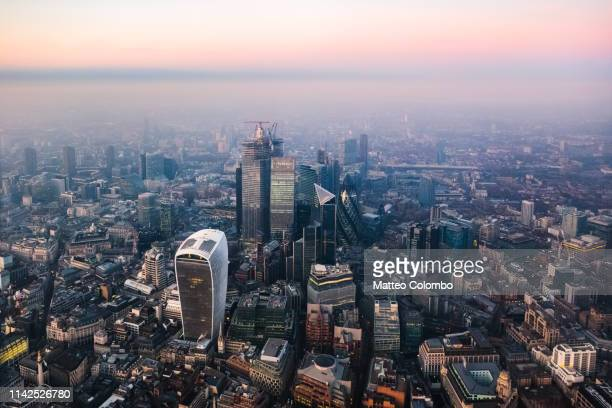 aerial view of the skyline of london at dusk, uk - greater london stock pictures, royalty-free photos & images