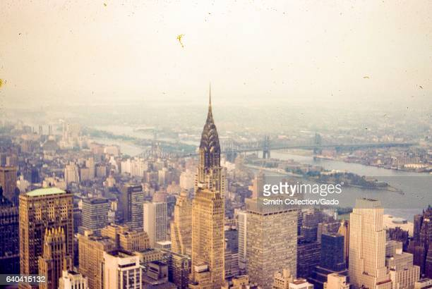 Aerial view of the skyline of New York City New York with the Empire State Building visible 1959