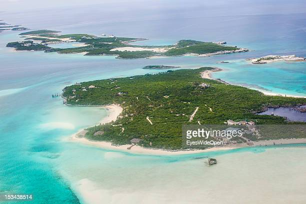 Aerial view of the small atolls lagoon islands and turqouis waters of the carribean sea of the Exumas seen from an airplane on June 15 2012 in The...