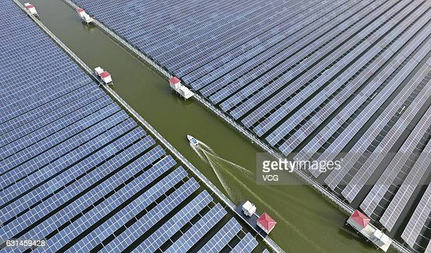 Aerial view of the solar power plant over a fish pond in Cixi on January 10, 2017 in Ningbo, Zhejiang Province of China. The solar power plant built...
