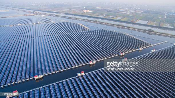 Aerial view of the solar power plant over a fish pond in Cixi on December 8 2016 in Ningbo Zhejiang Province of China The solar power plant built on...