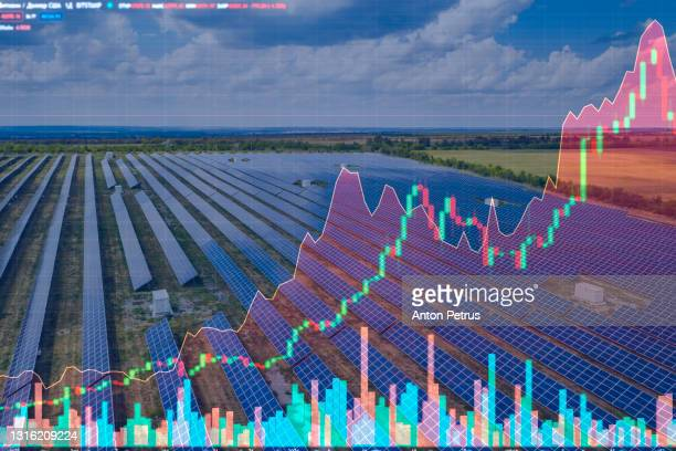 aerial view of the solar power station on the background of stock charts. alternative energy - finance and economy stock pictures, royalty-free photos & images