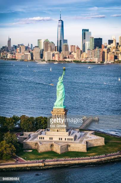 aerial view of the statue of liberty in front of manhattan skyline. new york. usa - one world trade center stock pictures, royalty-free photos & images