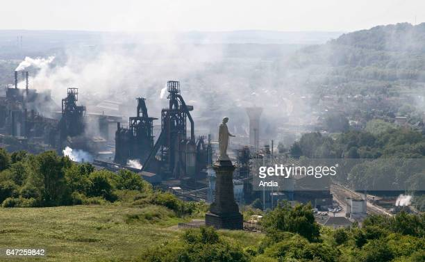 Aerial view of the statue of the Virgin Mary at the panoramic viewpoint 'Belvedere de Hayange' facing the blast furnaces in the Fensch Valley