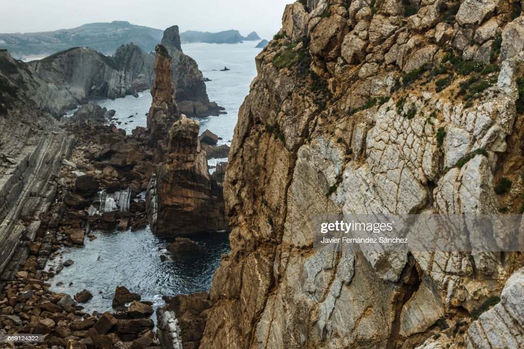 Aerial view of the steep coast of the cliffs in Liencres, Cantabria, Spain. : Stock Photo
