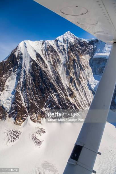 aerial view of the steep nw face of mt. hayes, the tallest mountain in the eastern half of the alaska range - miley fotografías e imágenes de stock