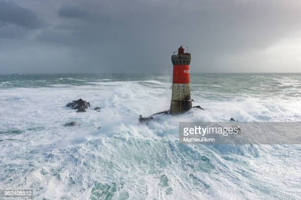 aerial view of the storm in brittany with huge waves on lighthouse - finistere stock photos and pictures