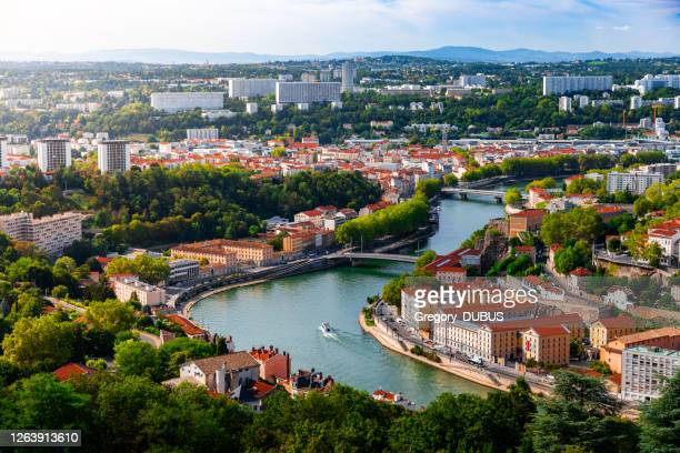 aerial view of the suburbs of lyon french city along saone river with some residential buidings and boats sailing - lyon stock pictures, royalty-free photos & images