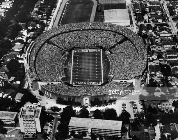 Aerial view of the Sugar Bowl stadium filled with spectators during a college football game on the campus of Tulane University New Orleans Louisiana...