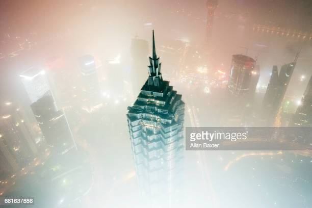 Aerial view of the summit of 'Jin Mao' tower and Shanghai skyline